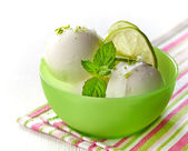 Bowl of fresh lime sorbet decorated with lime and mint — Stock Photo