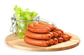 Sausages on cutting board — Stock Photo