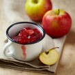 Cup of apple and berry jam — Stock Photo