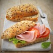 Sandwich with ham and tomatoes — Stock Photo