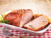 Pork loin on white plate — Stock fotografie