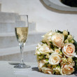 Wedding bouquet and glass of champagne — Stock Photo #30691401