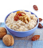Bowl of oats porridge — Stock Photo