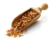 Wooden scoop with dried spices — Stock Photo