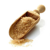 Wooden scoop with brown sugar — Stock Photo