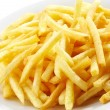 Plate of french fries potatoes — Stock Photo