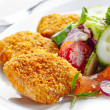 Chicken nuggets and vegetable salad — Stock Photo