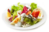 Fresh salad with eggs and anchovies — Stock Photo