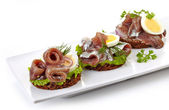 Canapes with anchovies and egg — Stock Photo