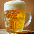 Stock Photo: Frosty glass of light beer