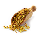 Bee pollen in a wooden scoop — Stock Photo