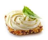 Bread with melted cream cheese — Stock Photo