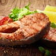 Grilled salmon steak slices — Stock Photo #38119393