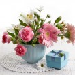 Bouquet of flowers and gift box — Stock Photo