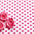 Stock Photo: Polka dot paper and pink decorative roses