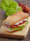 Sandwich with serrano ham and vegetables — Stock Photo