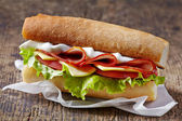 Sandwich with serrano ham and vegetables — Stockfoto
