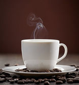 Steaming coffee cup — Stock Photo