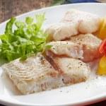 Fried pangasius fish fillet pieces — Stock Photo #49360829