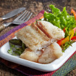 Fried pangasius fish fillet pieces — Stock Photo #49360853