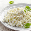 Cottage cheese on white plate — Stock Photo #50087233