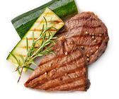 Grilled beef steak on white plate — Stock Photo