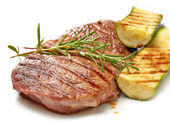 Grilled beef steak and zucchini — Stock Photo