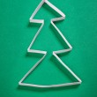 Paper christmas tree on green background — Stock Photo #7948105