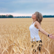 A girl in a wheat field — Stock Photo #4440124