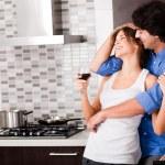 Couple hug in their kitchen — Stock Photo #1147964