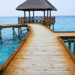 Wooden path leading to gazebo - Stock Photo