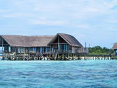 Sea facing cottages on maldive island — Stock Photo