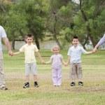 Happy family holding hands — Stock Photo #3136431