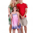 Happy family of four standind and looking at you — Stock Photo #3309215