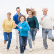Happy family jogging atthe beach — Stock Photo #42701425