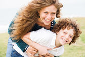 Loving mother and son playing — Stock Photo