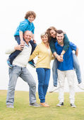 Family enjoying at park — Stock Photo