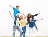 Cheerful family having fun on holiday — Stock Photo