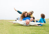 Happy family playing at park — Stock Photo