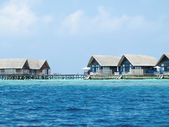 Water villa cottages on island — Stock Photo