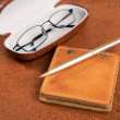 Business  still-life with a pen and glasses - Stock Photo