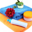 Still-life with bath towel shampoo and a flower — Stock Photo