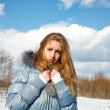 Girl in the solar winter afternoon in park — Stock Photo #22574567