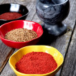 Stock Photo: Spices and mortar with pestle on table