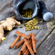 Still-life of spice and mortar on a wooden table — Stock Photo