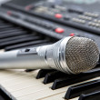 Microphone on keys of a musical synthesizer — Stock Photo