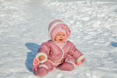The little girl cries sitting on snow — Stock Photo