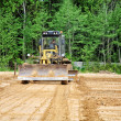 Stock Photo: Grader clears away ground