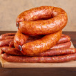 Stock Photo: Smoked sausage on a kitchen table