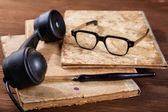 Still-life with old writing-books a nib and phone — Stock Photo